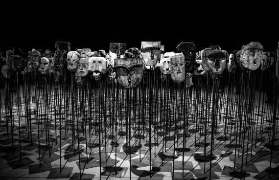 greyscale-photo-of-masks-on-a-stick